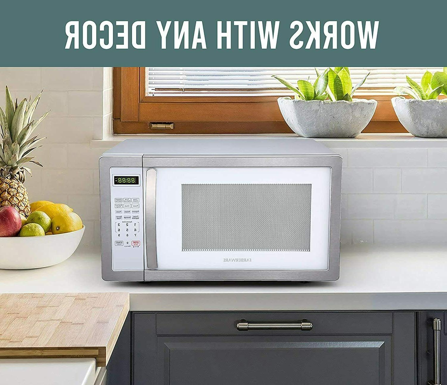 Farberware 1.1 Cu. Microwave Oven with LED Lighting Feet, White/Plat